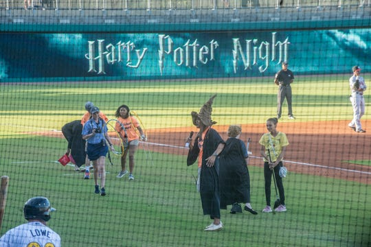 Kids played wizard games between innings on Saturday during Harry Potter Night for the Montgomery Biscuits at Riverwalk Stadium.