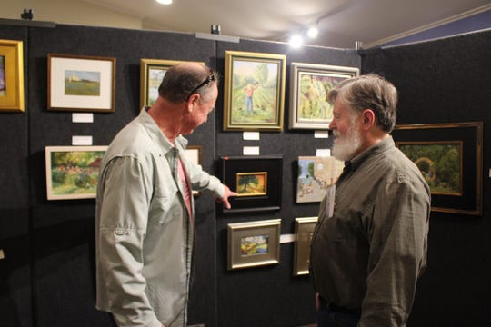 Members of the community view paintings created during the 2018 Pike Road Plein Air Paint Out.