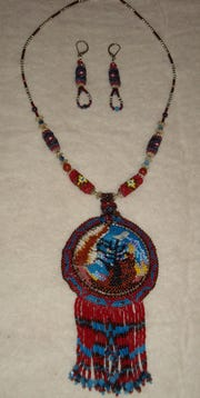 """Bead weaving necklace and earrings """"Homage"""" by Muncie Artists Guild May Featured  Artist Maria Walker."""