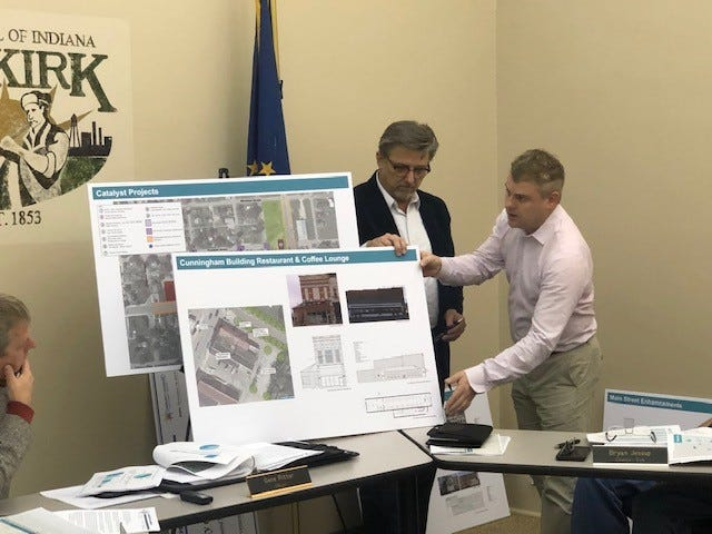 Ken Rememschneider of Kimley Horn and Brent Mather of R and B Architects work on strategic planning with the City of Dunkirk.