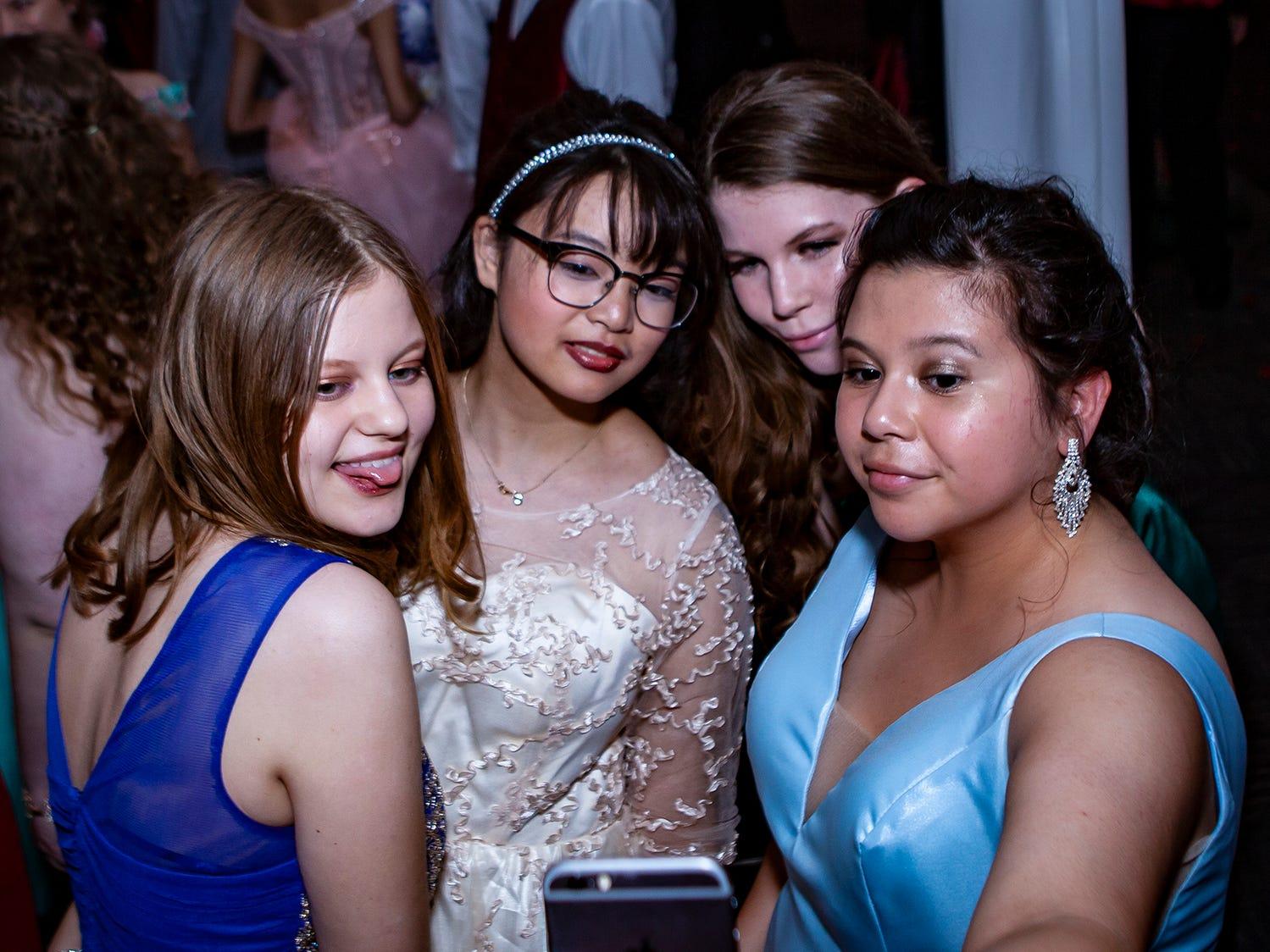Lily Baumgartner, Aimee Zhang, Loren Kaler and Val Jurado snap a selfie at Riverdale's prom, held Saturday, April 27, 2019 at MTSU's Student Union Building.