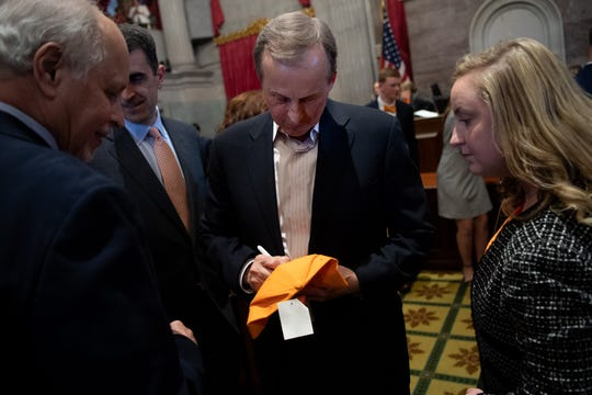 Tennessee men's college basketball coach Rick Barnes signs autographs after being honored during a joint convention at the state Capitol building in Nashville, Tenn., Monday, April 29, 2019.