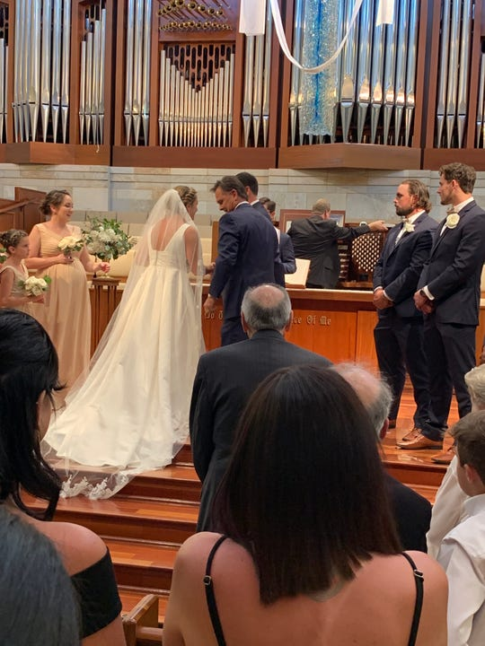 Naples High football coach Bill Kramer gives his daughter Katie away, just before Katie exchanged wedding vows with John Walker on Saturday. At right are best men Brian and Michael Walker. Michael Walker, who was a star at Naples High before a stellar four-year career at Boston College, agreed to a free-agent deal with the Jacksonville Jaguars hours after his brother got married.