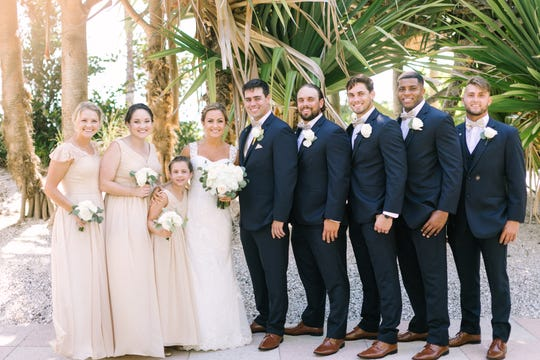 Newlyweds John and Katie Walker pose with their siblings after the ceremony Saturday. From left are Kelly Kramer, Courtney Epperly, Cassie Kramer, Katie Walker, John Walker, Brian Walker, Michael Walker, Devin Walker and Tyler Costa Walker. Michael Walker, a Naples High graduate and star return man/receiver at Boston College, signed a free-agent deal with the Jacksonville Jaguars hours after his brother got married.