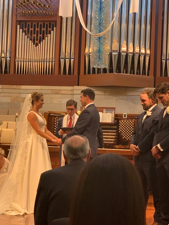 Katie Kramer, left, joins hands with John Walker at the couple's wedding ceremony Saturday at First Presbyterian Church in Naples. At right are best men Brian and Michael Walker, brothers of the groom. Michael Walker, who was a star at Naples High before a stellar four-year career at Boston College, agreed to a free-agent deal with the Jacksonville Jaguars hours after his brother got married.
