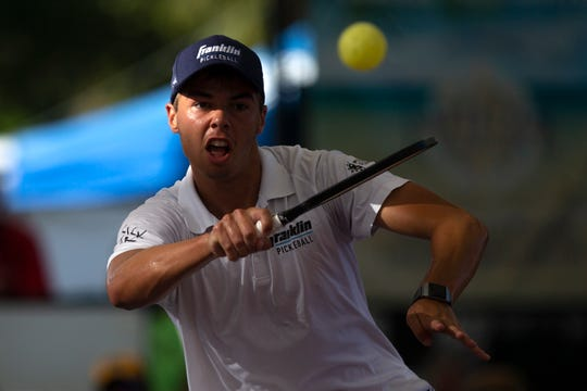Paul Olin returns the ball to his opponent Scott Moore during the Men's Pro Singles championship match Sunday during the U.S. Open Pickleball Championships on the Zing Zang Championship Court at East Naples Community Park.