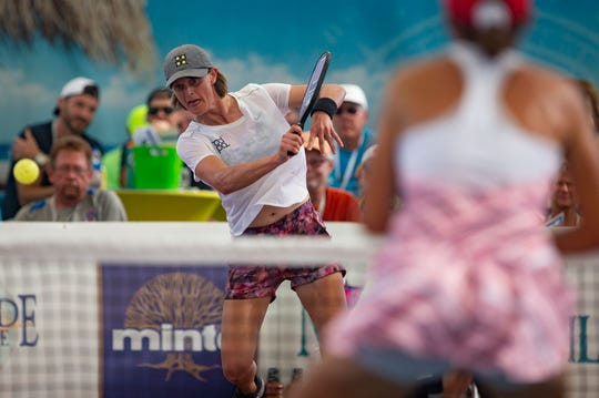 Irina Tereschenko returns the ball to Simone Jardim in the Women's Pro Singles pickleball championship game Sunday, April 28, 2019, on the Zing Zang Championship Court at East Naples Community Park.