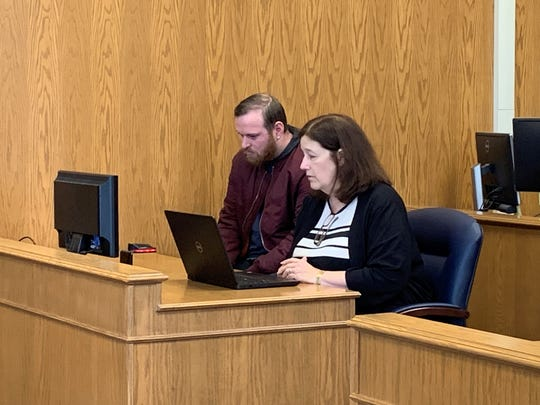 Phillip Taylor (left) sits beside his attorney Kristin Burkett during a sentencing hearing in Licking County Common Pleas Court on Monday, April 29, 2019.