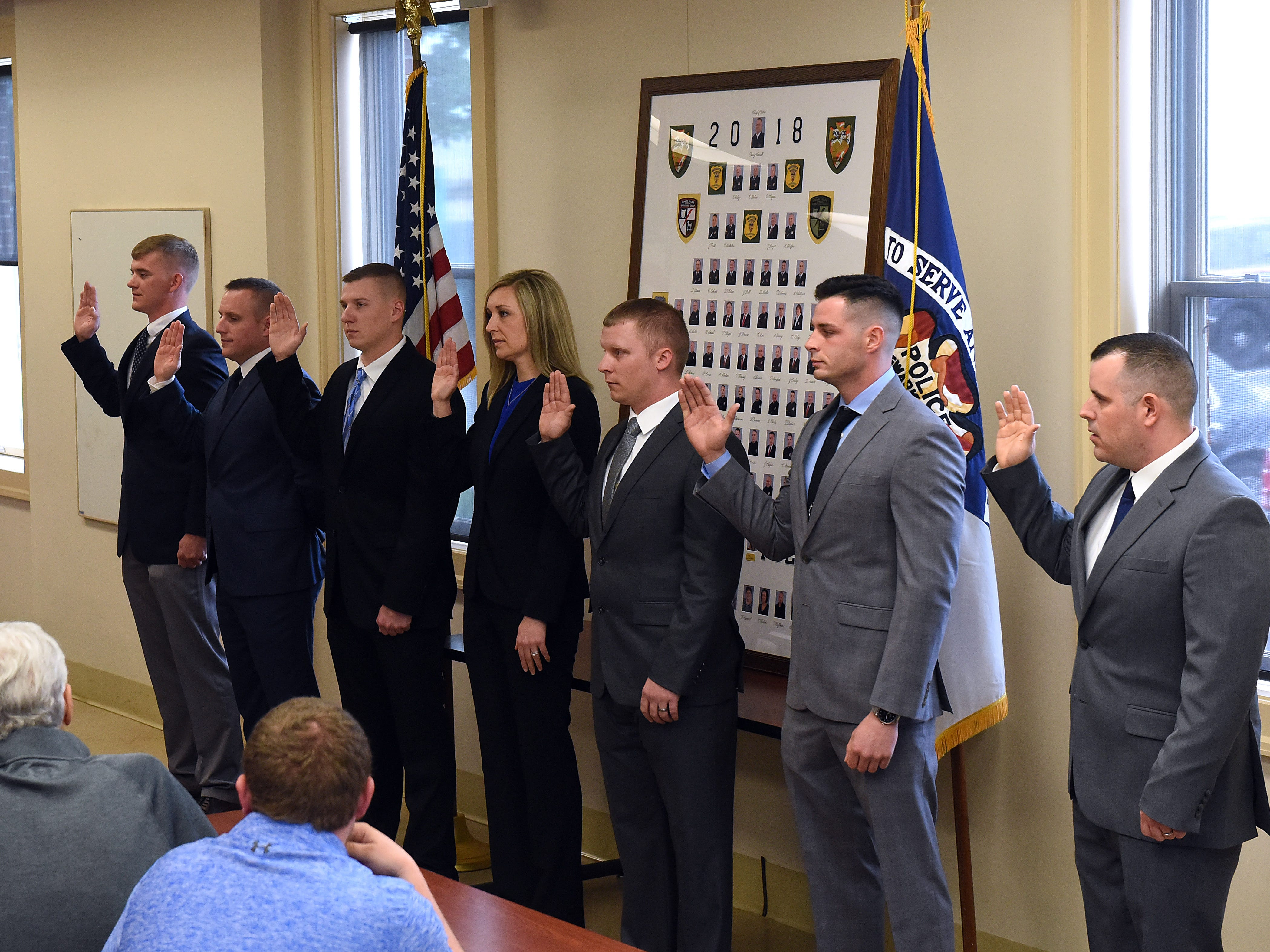City of Newark Safety Director Steve Baum administers the oath to seven new Newark City Police officers; Joshua Craft, Jacob OÕNeal, Robert Brown, Lindy Jewell, Justin Cortez, and Brandon Shepherd, during a ceremony on Monday, April 29, 2019.