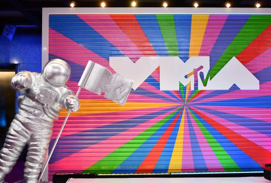 This Aug. 20, 2018 file photo shows a statue of the MTV Moon Man on the red carpet at the MTV Video Music Awards in New York. The network announced Monday that its annual awards show will take place Aug. 26 at the Prudential Center in Newark, New Jersey.