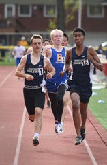 Jeremy Bronstein of Dwight Englewood (L) makes his way to finish in the Liberty boys 1600 meter during the NJIC Patriot and Liberty Divisional track meet at Emerson Jr./Sr. High School in Emerson on 04/29/19.