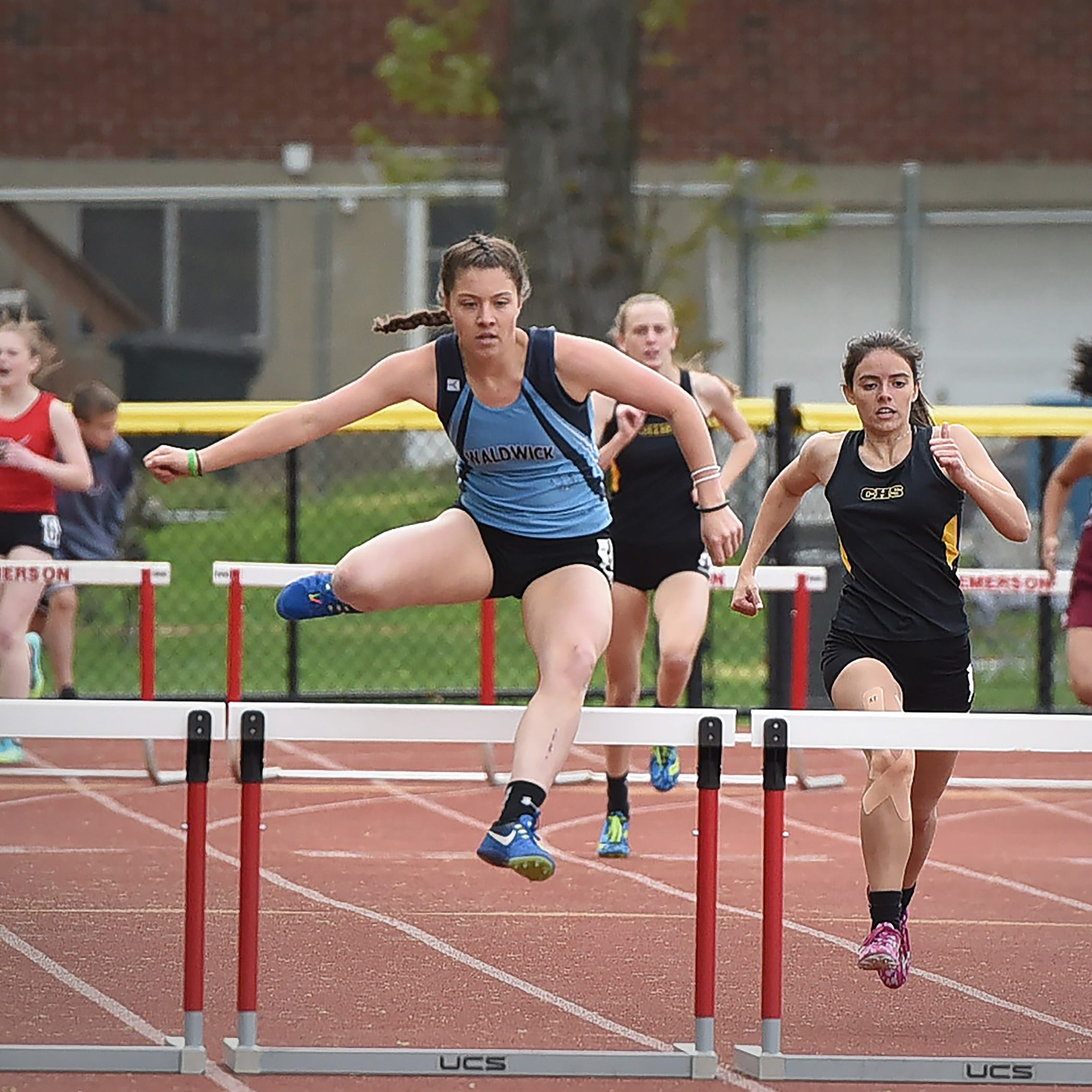 Samantha Stallard of Waldwick makes her way to finish first in the Patriot girls 400 meter hurdle during the NJIC Patriot and Liberty Divisional track meet at Emerson Jr./Sr. High School in Emerson on 04/29/19.