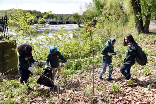Seven Paterson schools participated in the seventh annual Earth Day Clean-Up of the Great Falls National Historic Park on Monday, April 29, 2019. Students from Paterson Academy for The Gifted and Talented collected trash along the falls.