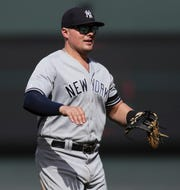 New York Yankees first baseman Luke Voit (45) reacts after a win against the San Francisco Giants at Oracle Park.
