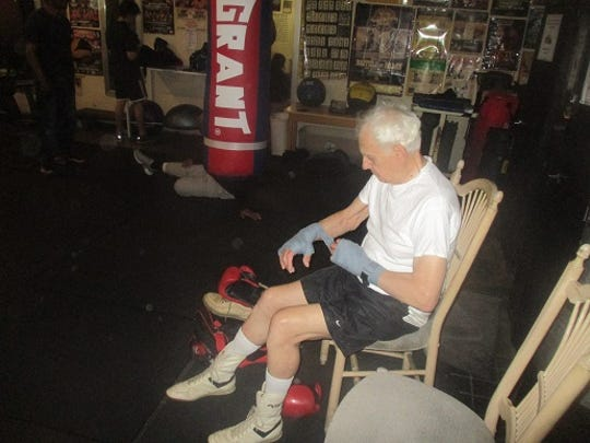 Pierre Benoist tapes his hands as he prepares for a sparring match.