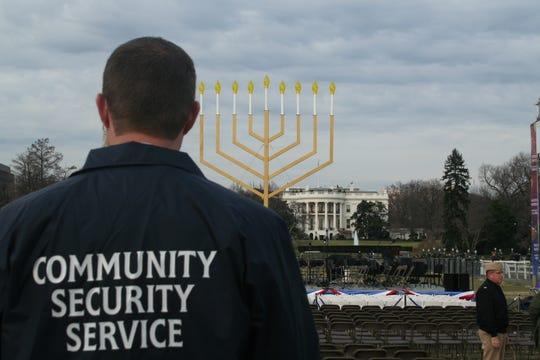A CSS volunteer guarding the Chabad national menorah lighting in Washington, DC