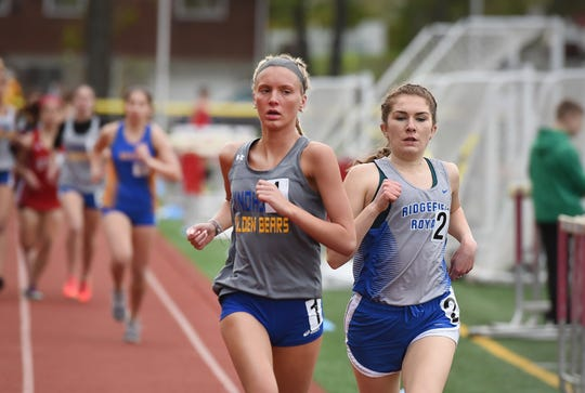 Giulia Pezzullo of Lyndhurst (L) competes against Mary Griffin of Ridgefield (R) as she runs to take first place in the Liberty girls 1600 meter  during the NJIC Patriot and Liberty Divisional track meet at Emerson Jr./Sr. High School in Emerson on 04/29/19.