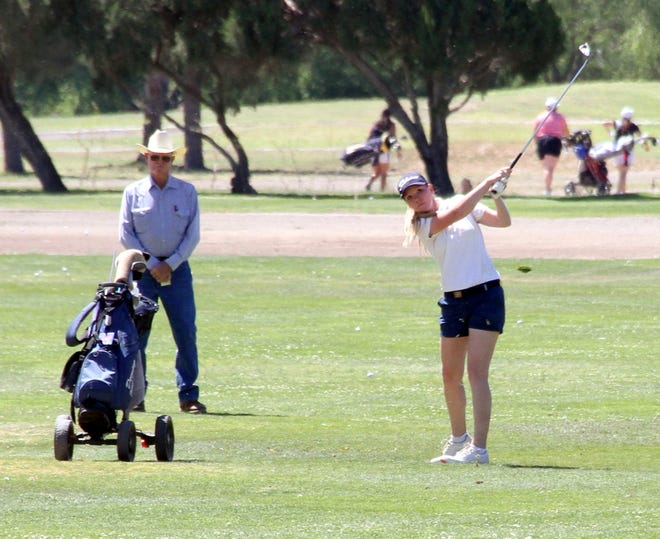 Junior Lady 'Cat Dezi Stockton struck her approach on No. 18 during Thursday's Deming Invitational Golf Tournament at Rio Mimbres golf course.
