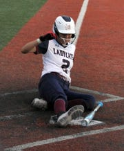 Sophomore Lady 'Cat Jenae Jasso slides into home plate on Friday during Deming High's District 3-5A double-header sweep over the visiting Mayfield High Trojans.