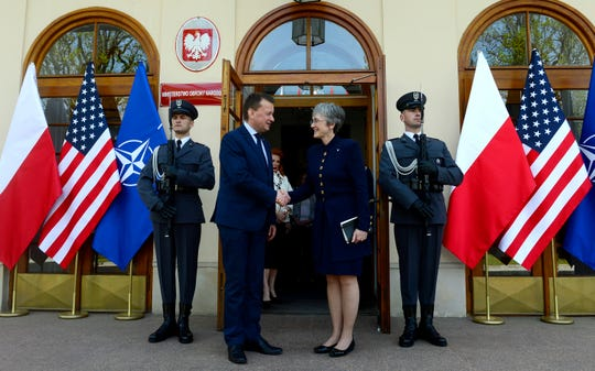 Secretary of the Air Force Heather Wilson greets the Polish Minister of Defense Mariusz Blaszczak in Warsaw, Poland, April 25, 2019.