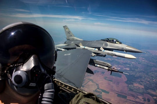 U.S. Air Force Senior Airman George Rahe, 54th Operations Support Squadron Aircrew Flight Equipment Airman, takes a selfie during a familiarization flight in an F-16 Fighting Falcon during a temporary duty assignment with the 8th Fighter Squadron, March 29 to April 12, at Naval Air Station Joint Reserve Base New Orleans, La. Many personnel were given the opportunity to go on a FAM ride in the back of an F-16 D-model during the TDY.