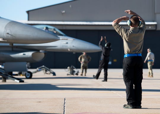 311th Aircraft Maintenance Unit crew chiefs marshal F-16 Fighting Falcons as they prepare to taxi, April, 25, 2019, on Hill Air Force Base, Utah. Over 200 personnel and 16 F-16s were deployed to Hill for exercise Venom 19-01.