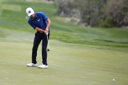 Piedra Vista's Trey Diehl attempts a long putt on the eighth green during Monday's PV Invitational at Piñon Hills Golf Course in Farmington.