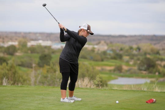 An EPA website reported that regional ozone levels were low Monday when high school athletes competed during Monday's Piedra Vista Invitational at Piñon Hills Golf Course in Farmington. Aztec's Isabelle Peralta swings at her ball on the first-hole tee box.  Check www.airnow.gov if planning outdoor activities during times when air quality is poor.