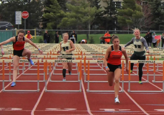 Abby Dunn won both the 100 and 300 meter hurdles for Northville against Howell.