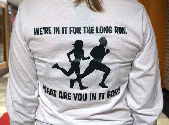 Emily Britton, a Plymouth High senior, sports this year's SJ5K t-shirt with its slogan. Britton has been involved with the SJ5K since its inception.