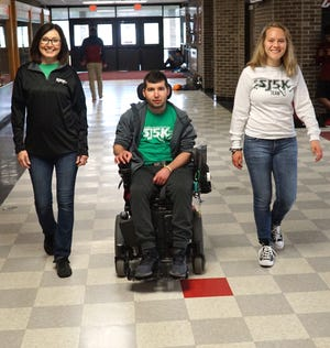 Barbara Lindlbauer, her son Jesse, Emily Britton, right, and hundreds of others will team up this Sunday May 5 at the PCEP varsity track to raise funds for the SJ5K - which will be dedicated to other area families dealing with the recovery from traumatic illnesses. Jesse himself plans on rolling around the track on his recumbent bicycle.
