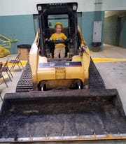 Evan Brook enjoyed the skid-steer loader at last year's DPS Open House event.