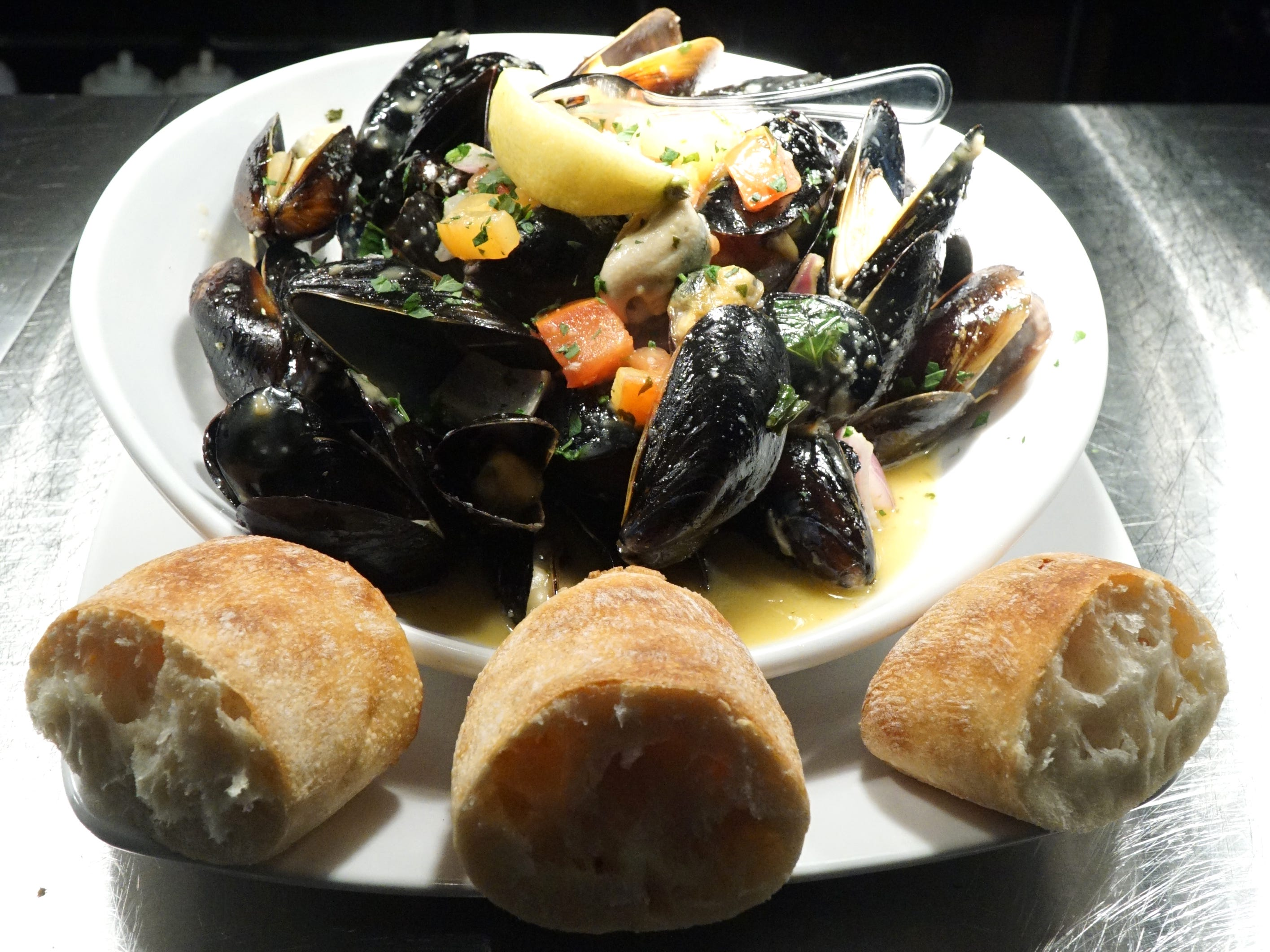 Sedona Taphouse's PEI mussels with sauteed vegetables and butter broth.