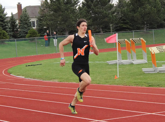 Demetri Zervos was on the winning 400 and 800 meter relays for Northville in the team's meet against Howell.
