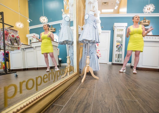 Owner Kelly Taylor talks Monday about her new Properly Posh Baby store in downtown Pensacola.