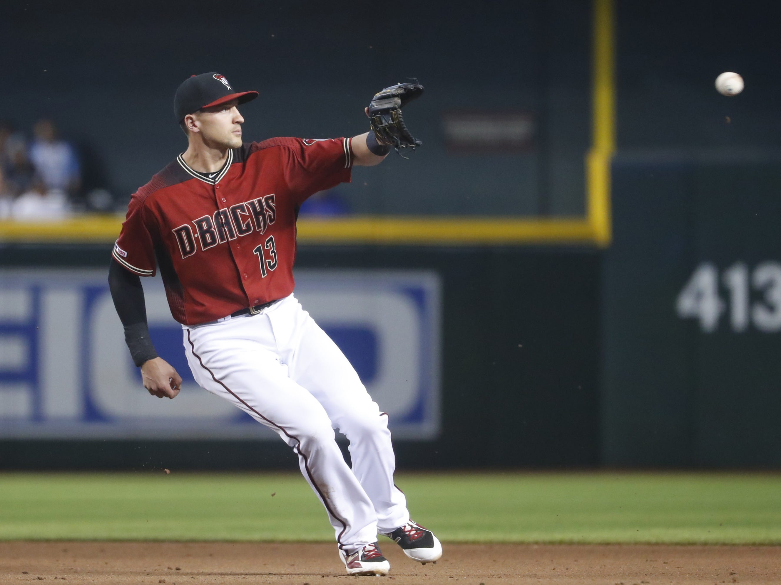 Diamondbacks' Nick Ahmed (13) catches a throw from the outfield during the fifth inning against the Cubs at Chase Field in Phoenix, Ariz. on April 28, 2019.
