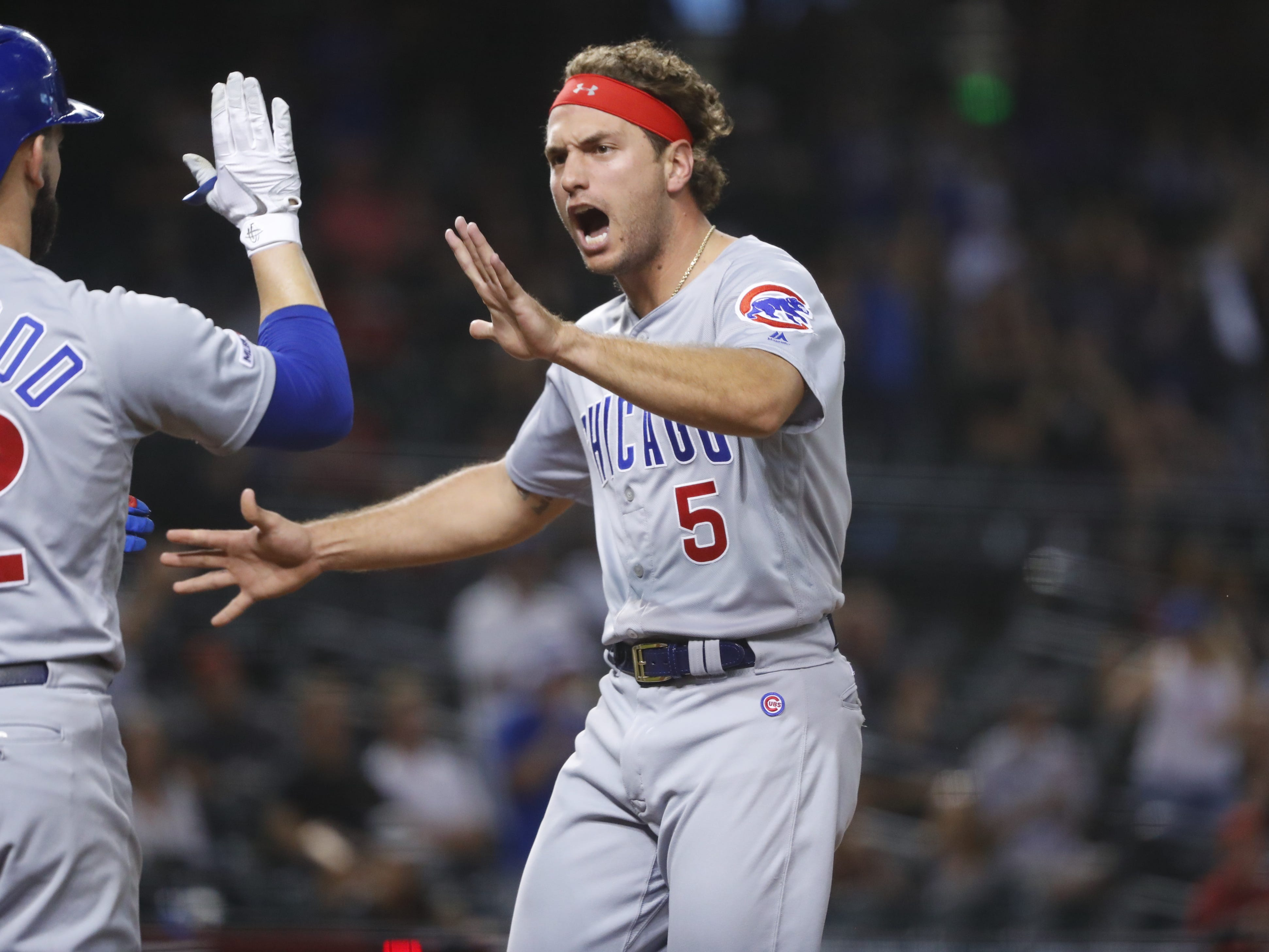 Cubs' Albert Almora Jr. (5) celebrates after scoring against the Diamondbacks during the 15th inning at Chase Field in Phoenix, Ariz. on April 28, 2019.