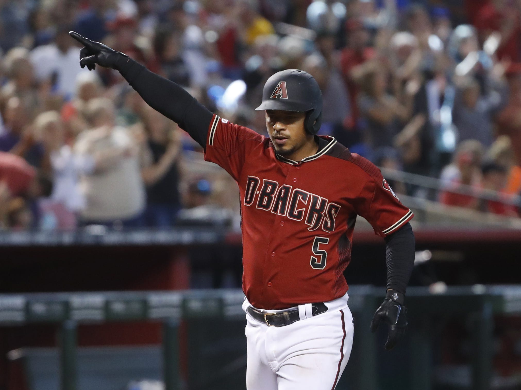 Diamondbacks Eduardo Escobar (5) rounds third for home after hitting a two-run homer during the sixth inning against the Cubs at Chase Field in Phoenix, Ariz. on April 28, 2019.