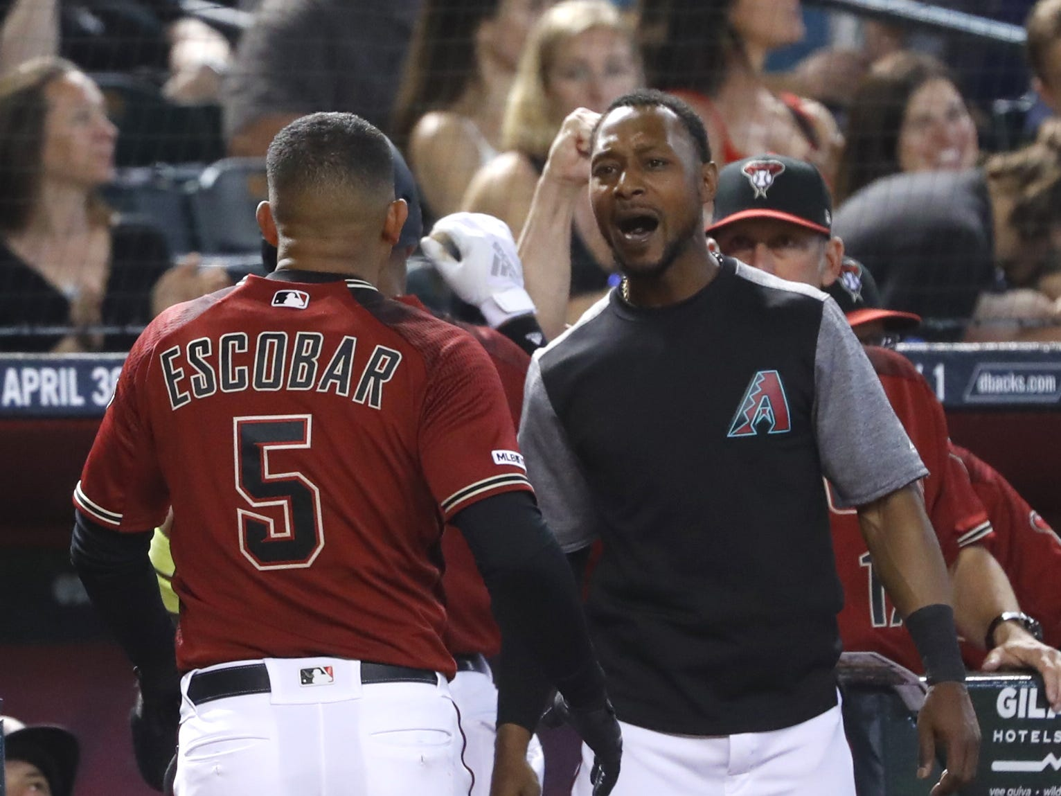 Diamondbacks' Jarrod Dyson (R) celebrates with Eduardo Escobar (5) after his second home run of the game during the sixth inning against the Cubs at Chase Field in Phoenix, Ariz. on April 28, 2019.