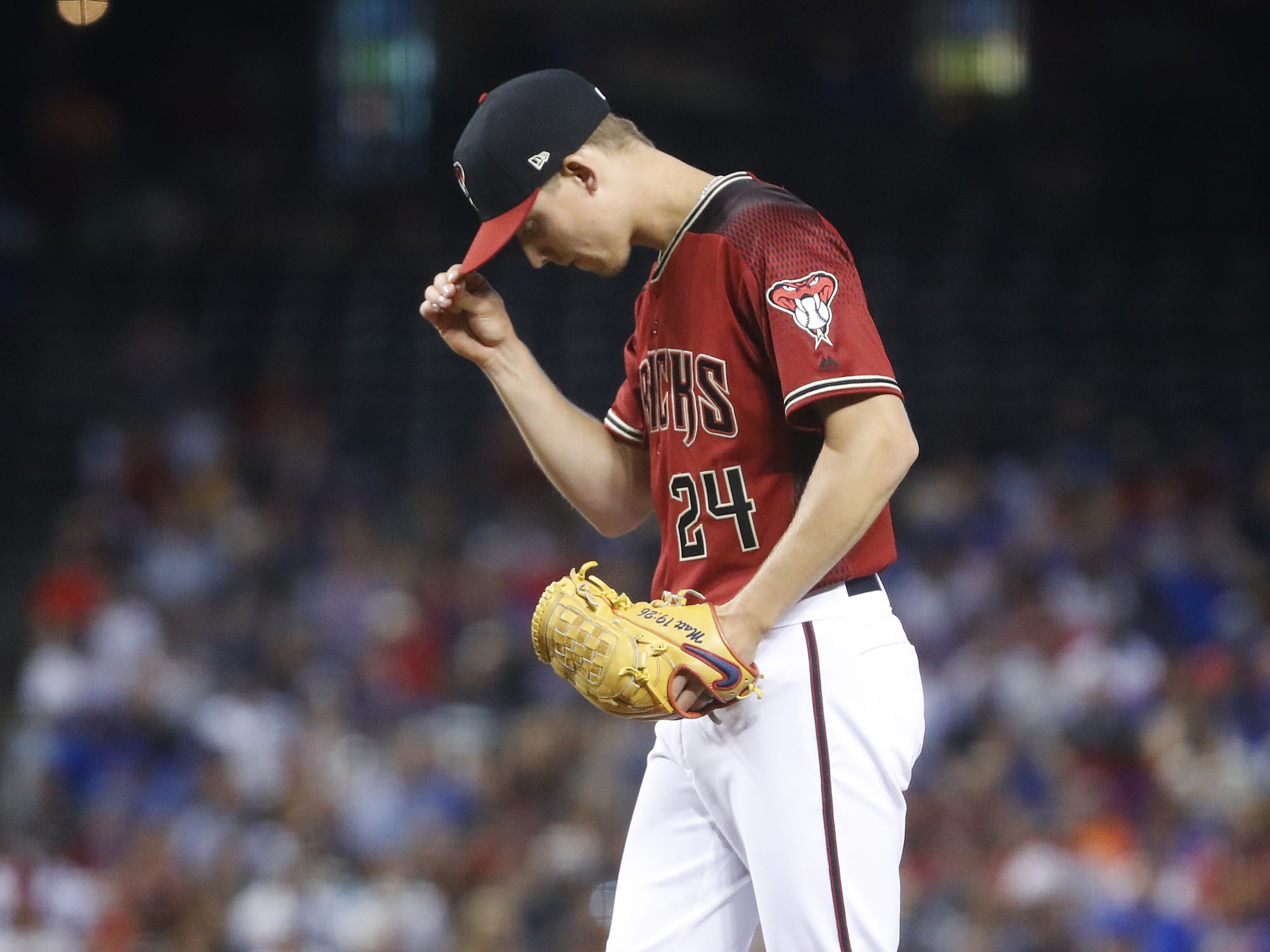 Diamondbacks' Luke Weaver (24) steadies himself on the mound during the first inning against the Cubs at Chase Field in Phoenix, Ariz. on April 28, 2019.
