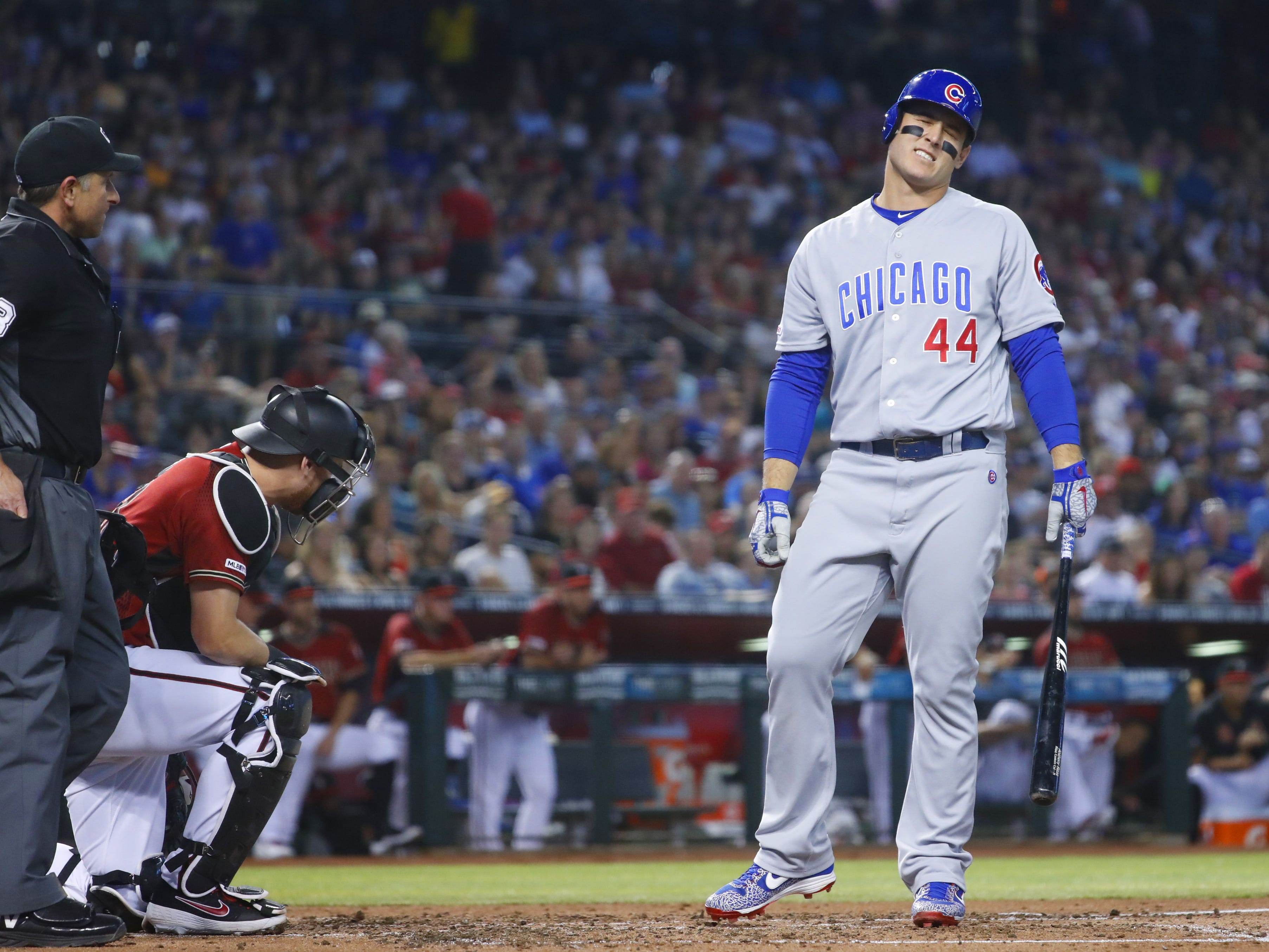 Cubs' Anthony Rizzo (44) reacts after being hit by a ball during the third inning by Diamondbacks' Luke Weaver at Chase Field in Phoenix, Ariz. on April 28, 2019.