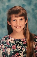 Up until she was in third grade, Jessica Pucci's mother kept her in bangs cut back over her ears.