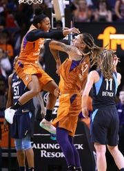 Briann January, left, is returning to playing full time after two years dividing her time between the Phoenix Mercury and being an ASU women's basketball assistant coach.