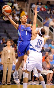 Former WNBA player Nikki Blue (1) is joining the Arizona State women's basketball staff, replacing Briann January, who is returning full time to her pro playing career.