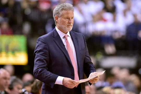 Philadelphia 76ers coach Brett Brown looks on during the first half of Game 1 of an NBA playoffs series against the Toronto Raptors.
