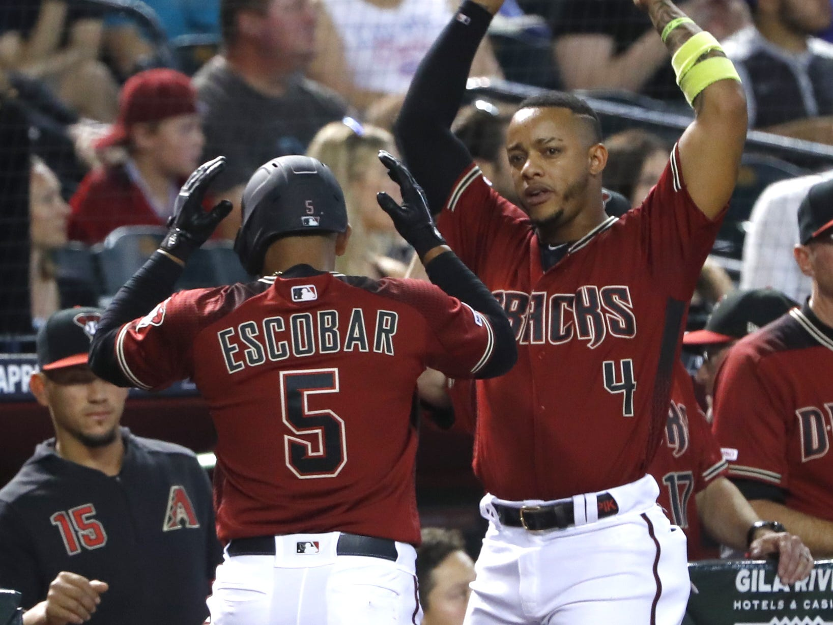 Diamondbacks' Eduardo Escobar (5) celebrates with Ketel Marte (4) after a home run during the fourth inning against the Cubs at Chase Field in Phoenix, Ariz. on April 28, 2019.