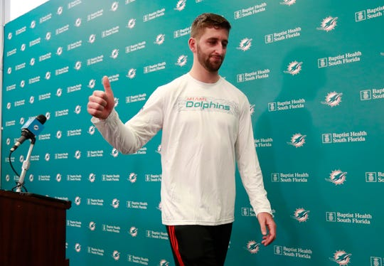 New Dolphins quarterback Josh Rosen gives a thumbs up as he leaves after answering questions at a news conference Monday.