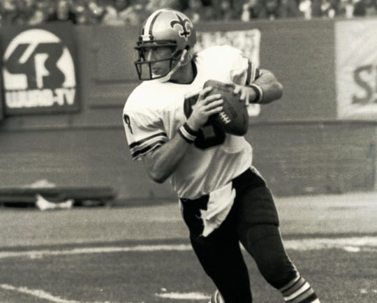 Saints quarterback Archie Manning looks down field during a game against the Browns at Cleveland Stadium.