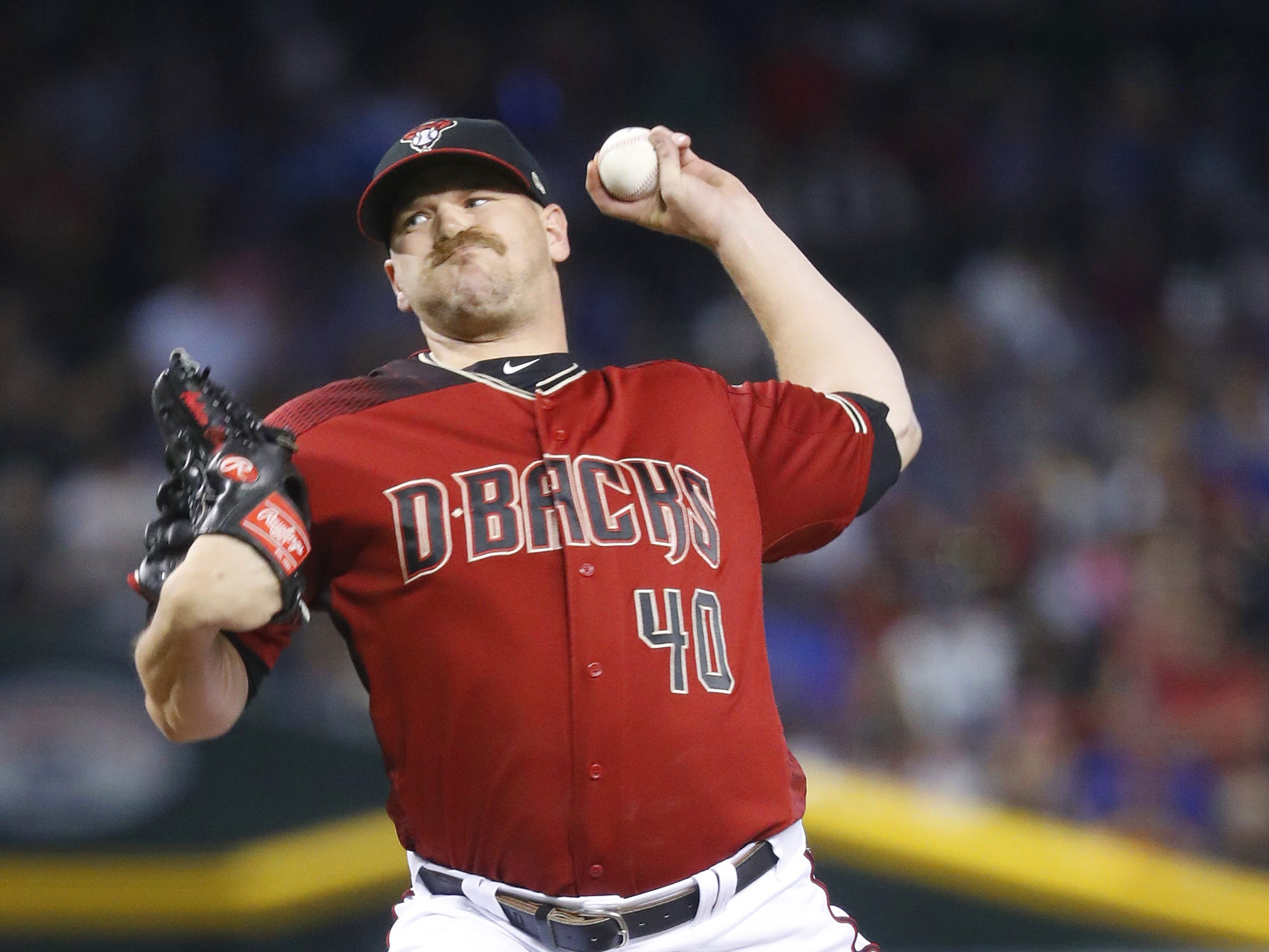 Diamondbacks' Andrew Chafin (40) pitches in relief against the Cubs during the sixth inning at Chase Field in Phoenix, Ariz. on April 28, 2019.