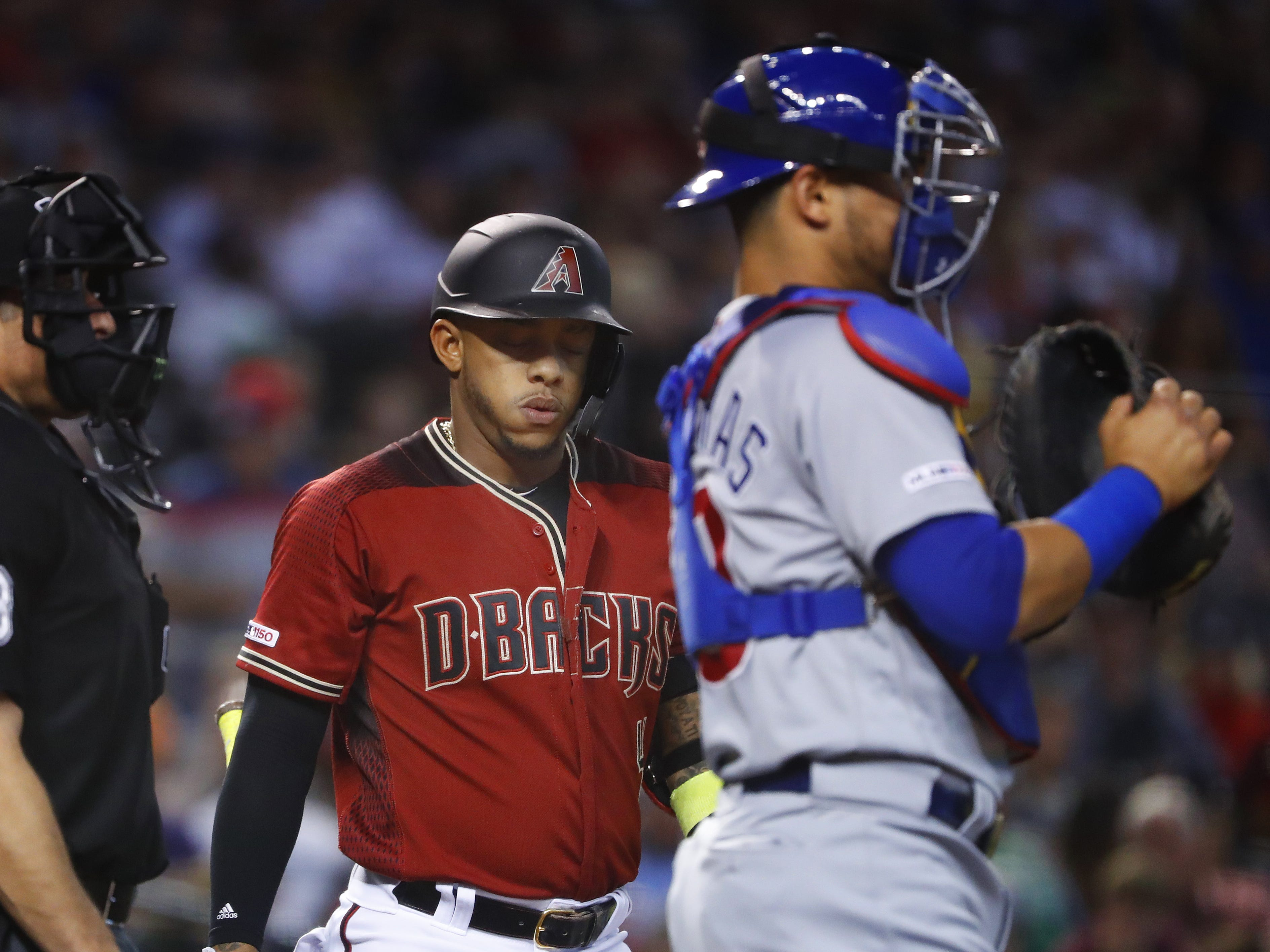 Diamondbacks' Ketel Marte (4) reacts to missing a pitch against the Cubs during the first inning at Chase Field in Phoenix, Ariz. on April 28, 2019.